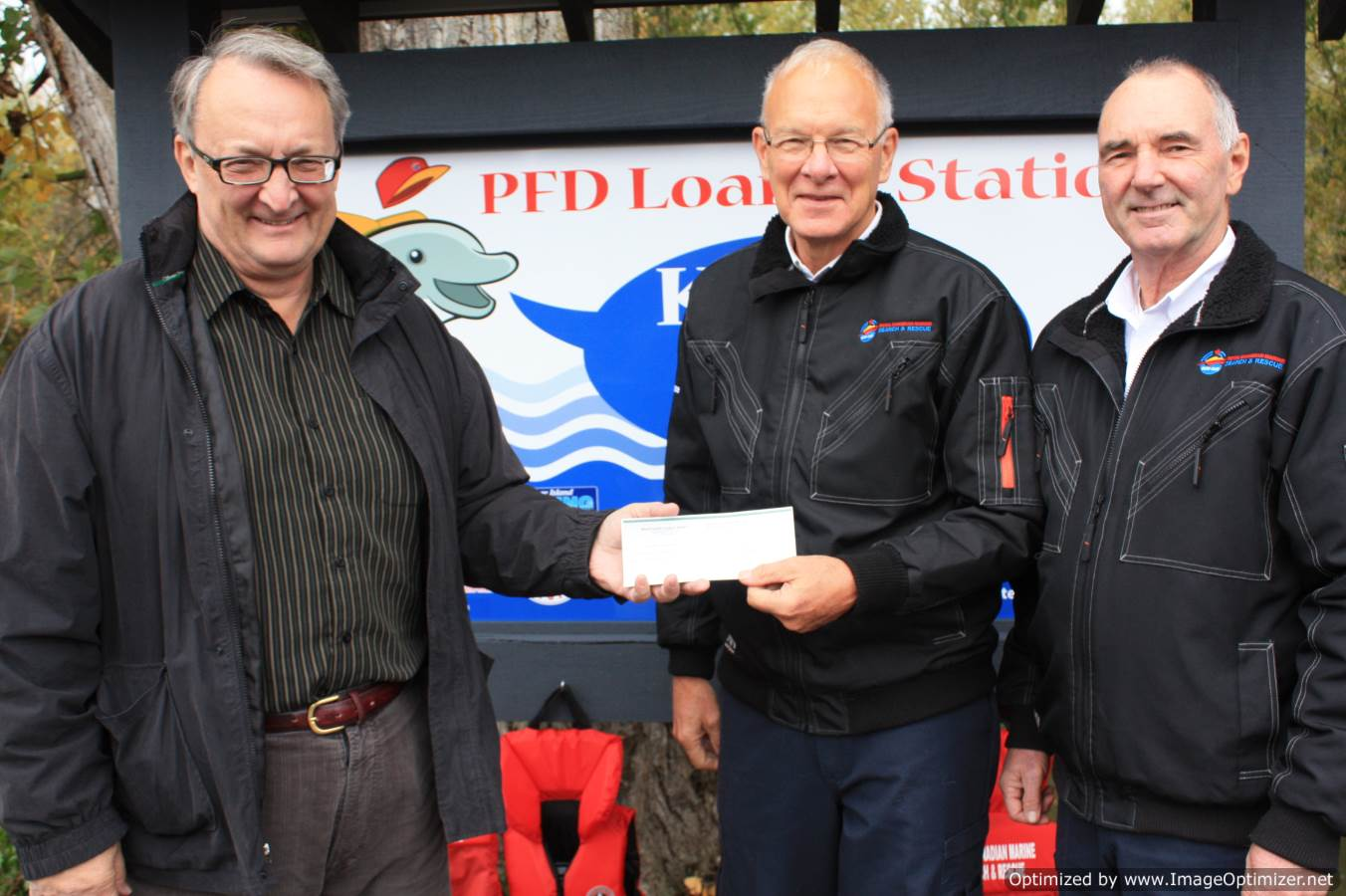 Paul Demenok making presentation to RCMSAR members Bruce Weicker and Rob Sutherland